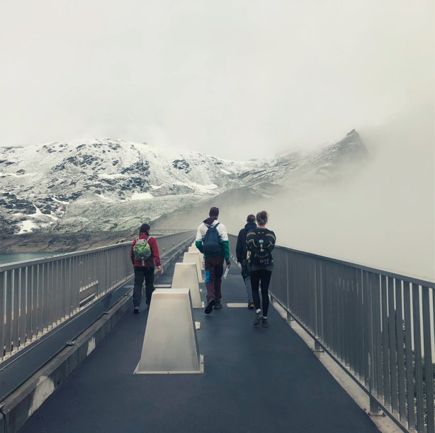 People crossing the bridge in the mountains