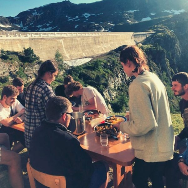 People eating in the mountains