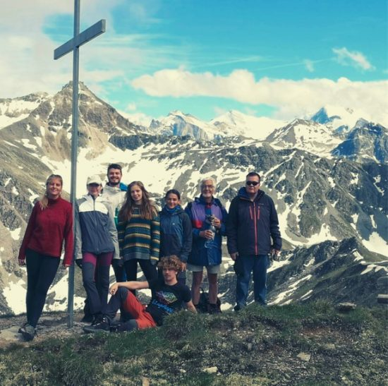 Group of people in front of a mountain